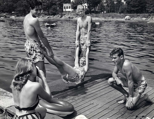 Eastman Kodak Advertisement, Summer Lake Scene of Teenager with Camera Making a Snapshot of Her Friends in Bathing Suits on a Dock, 1946-52