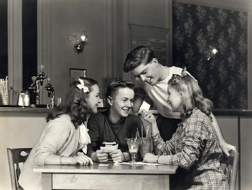 Eastman Kodak Advertisement, Teenager with Camera Sharing Snapshots with His Friends in a Soda Shop, 1946-52